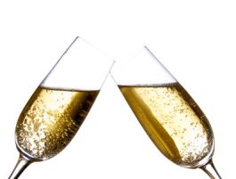 two champagne flutes touching in a toast